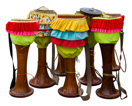 Isolates the drum Thailand, which are furnished with colorful rag  photo