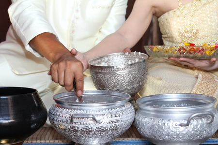 Thailand hands Groom bowl together from the wedding ceremony  photo