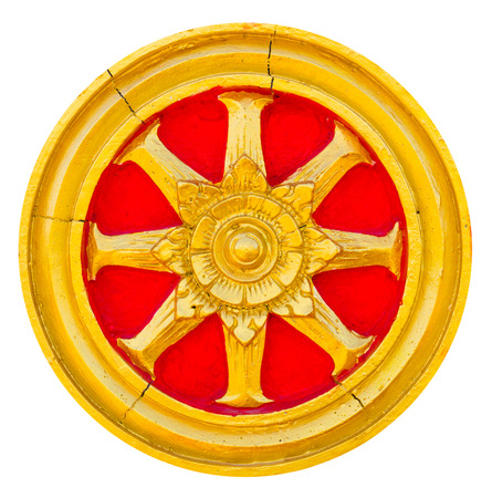 Isolate of art wheel of dhamma golden stucco with red trim  photo