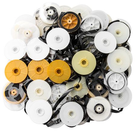 Isolated VHS tape that was disassembled into a pile together photo