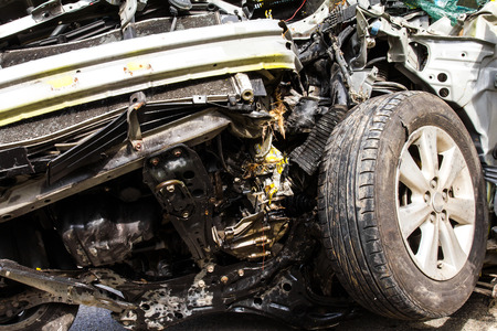 Details of the auto accident collision damage to the front tire  photo