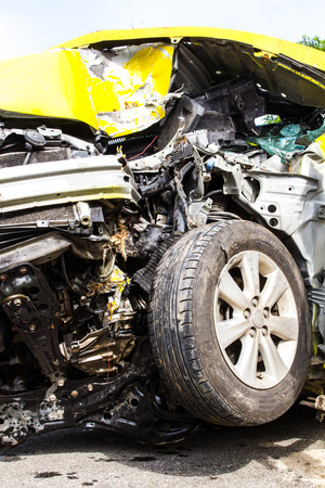 total loss: Details of the damage front Yellow car accident collision and tire
