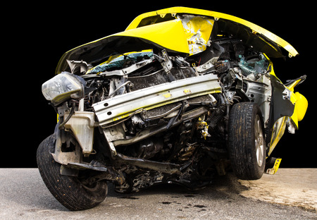 total loss: Isolate the front of the yellow car crash caused by accident hit a tree