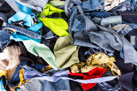Background pile of scrap fabrics  Derived from sewing repairs  Stock Photo