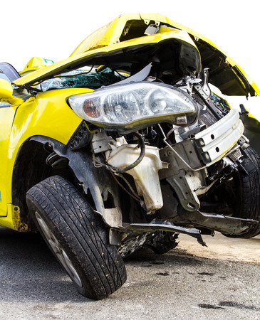 Isolate the front of the yellow car crash caused by accident  photo
