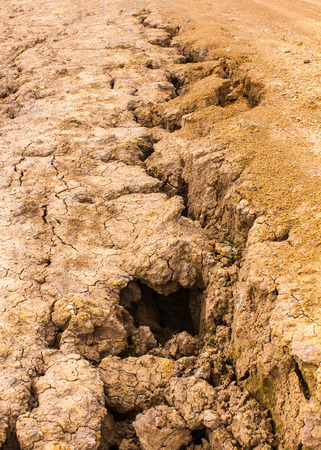 degradation: Details of road gravel to break due to water erosion disaster  Stock Photo