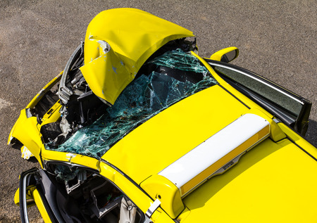 fender bender: Above the ruins of the yellow car collision accident on the road