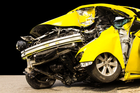 total loss: Isolate the front of the yellow car crash caused by accident  Stock Photo