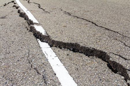 Asphalt road surface crack is dangerous because of corruption. photo