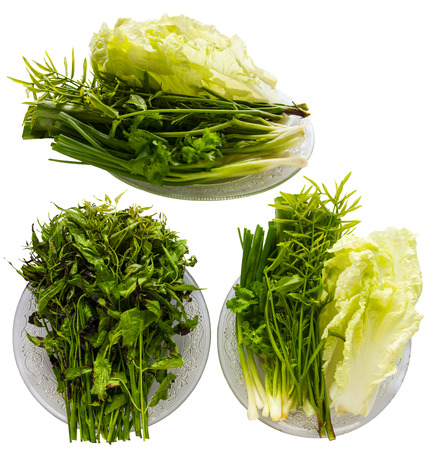 isolates: Isolates above the vegetable dish such as neem leaves, olives, lettuce. Stock Photo