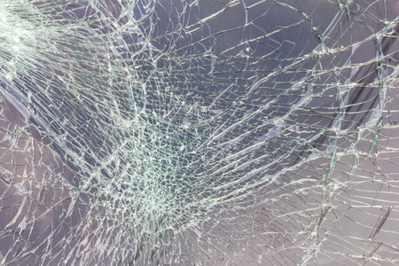 Close up of the windshield to crack due to an accident collided. Archivio Fotografico