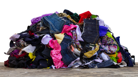 Isolated pile of fabric pieces from a variety of sewing repairs. Archivio Fotografico