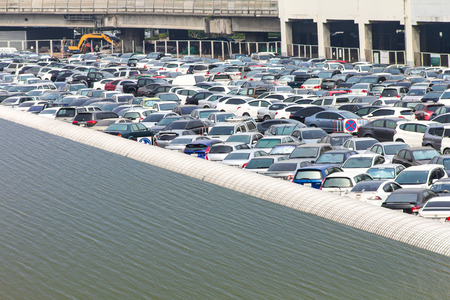Parking a car lot where water will flood the roof cover.