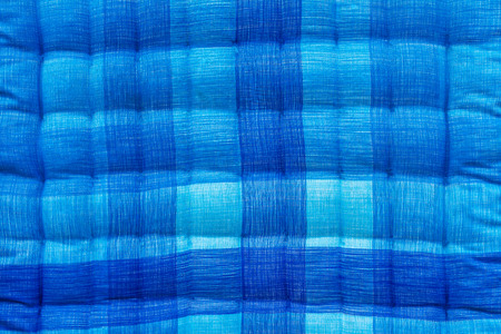 Close up background beautiful blue and white corrugated bed quilt. photo