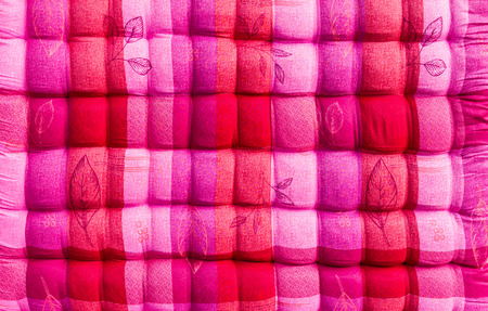 Close up background beautiful pink and white corrugated bed quilt. photo