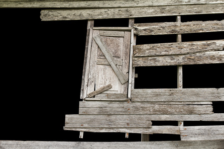 isolates: Isolates gap wooden walls and windows of old houses decayed. Stock Photo