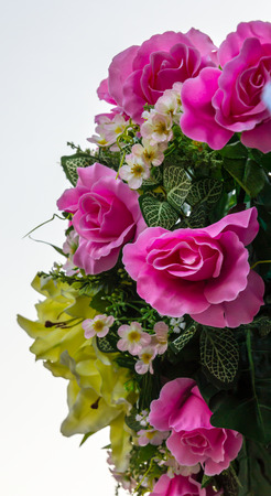 isolates: Isolates bouquet of pink roses and other decorations nicely.
