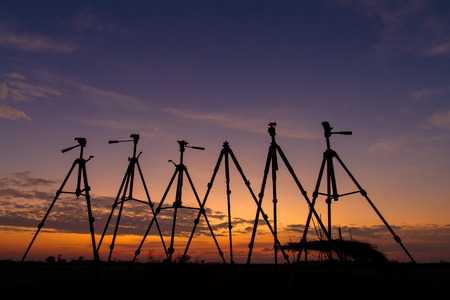 best shelter: Silhouette tripod are located in the beautiful countryside. Stock Photo