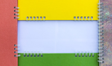 isolates: Isolates frame spine colorful calendars overlap space to enter text. Stock Photo