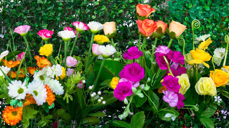 Colorful flower decoration on fake grass beautifully realistic. photo