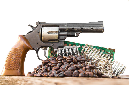 isolates: Isolates still life plastic toy gun set with coffee beans and more. Stock Photo