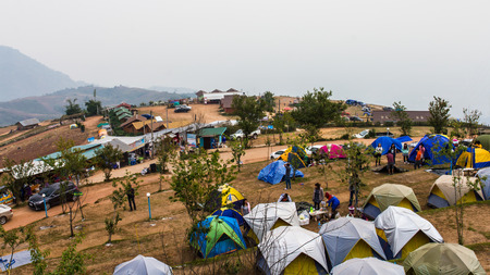 stay beautiful: People stay in a tent on a hill to watch the beautiful scenery of the early morning.