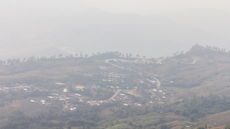 overrun: Smog has covered the mountain resort, which was overrun with deforestation.