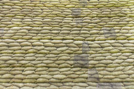 levy: Sacks small stack a wall of large mesh lined to prevent disasters.