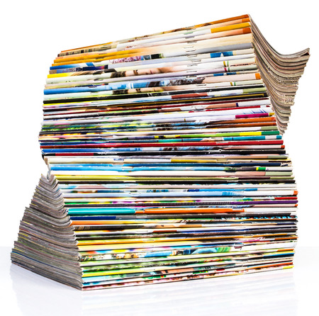 Isolates of spine journal publications stacked pile of twisted spiral layers. photo