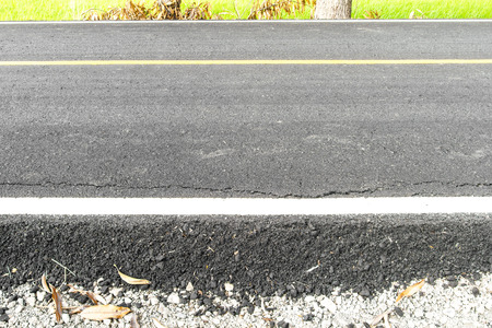 Surface side of the road, which traces cracking in rural Thailand rice. Stock Photo