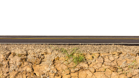 beneath the surface: Isolate the side of the new road paved with earth parched patch on the bottom.