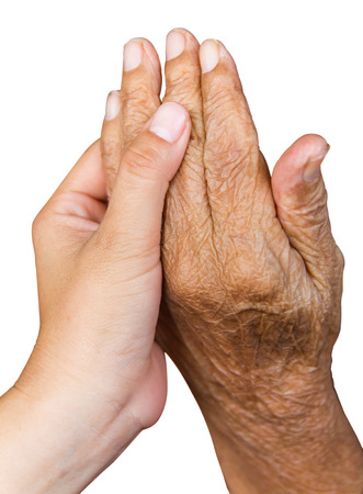 whose: Isolated hand holding the hand of a girl whose grandmother aging and wrinkles. Stock Photo