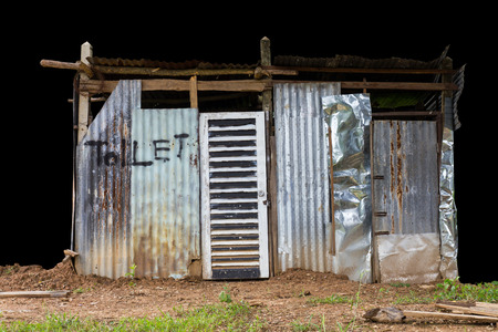 latrine: Isolates of toilet roofs, concrete and timber, which is on the mound. Stock Photo