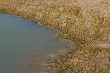 seepage: Close background soil surface dry above the water surface of the pond farmers.