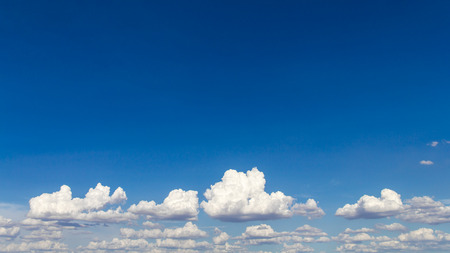 bright space: Blue sky background with a bright space with the fluffy white clouds beneath.