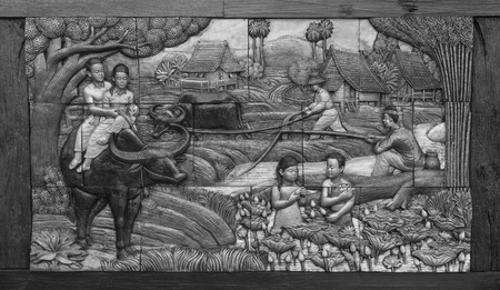 murals: Agriculture, rural lifestyle of Thailand ancient murals on concrete blocks, wooden frame. Stock Photo