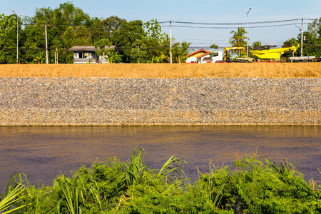 stabilization: Construction mesh stone walls to prevent water erosion near the road and at home.
