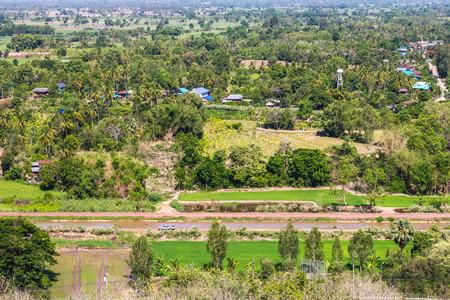 cut through: Thailand views above the road cut through the rural landscape where farming is the main occupation. Stock Photo