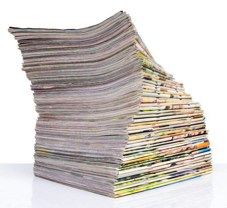 publications: Isolates of spine journal publications stacked pile of twisted spiral lay.