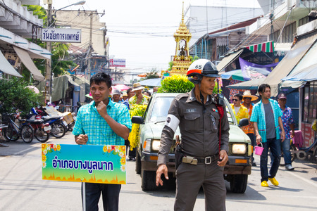 a white police motorcycle: Traffic police are hailing the safety car on the road in the Songkran Festival Thailand.On July 9, 2013 in Phichit, Thailand.