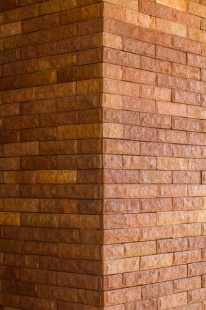 Close up corner of a brick wall Brown seamless, which is found mainly in the quaint temple. Archivio Fotografico