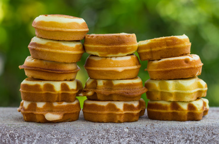 superimposed: Cookies, soft spherical array superimposed vertical rows with green blur the background.