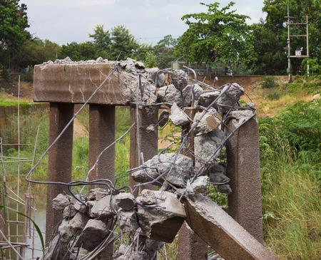 demolish: Destruction demolish a concrete bridge pillar with a giant hammer to repair and rebuild.