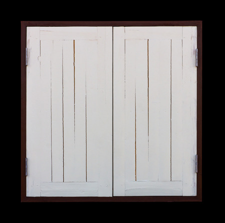isolates: Isolates two old wooden windows painted white in a closed, dark brown frame. Stock Photo