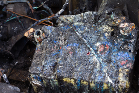suffered: Close up of old car batteries, which suffered a fire accident caused damage to both cars. Stock Photo