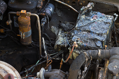 12v: Close up of old car batteries, which suffered a fire accident caused damage to both cars. Stock Photo