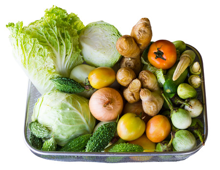 isolates: Isolates of various vegetables in a basket, which was preparing to cook a healthy meal.