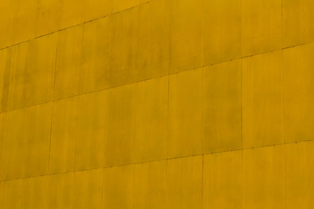 fixed: Texture background big yellow square steel plate, which is fixed with pins and joints smooth. Stock Photo