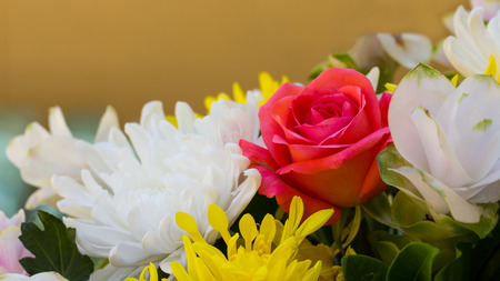 yellow rose: Pink roses with white flowers and yellow decorations together beautifully, but wither. Stock Photo