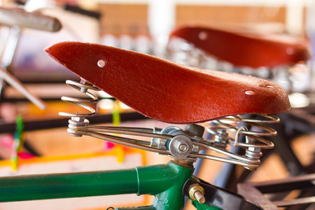 resemble: Close up vintage bicycle saddle brown, which was converted reconstructed to resemble the old.